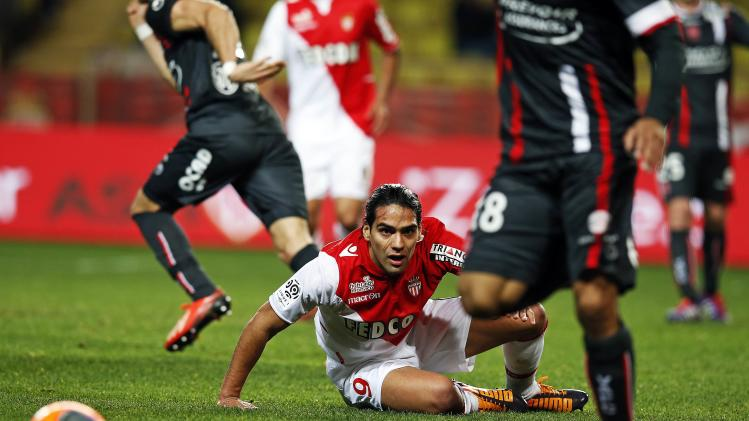 AS Monaco's Radamel Falcao sits on the field after falling during their French Ligue 1 soccer match at Louis II stadium