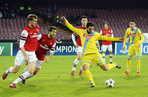 Napoli's Gonzalo Higuain scores, during a Champions League, group F, soccer match between Napoli and Arsenal, at the Naples San Paolo stadium, Italy, Wednesday, Dec. 11, 2013