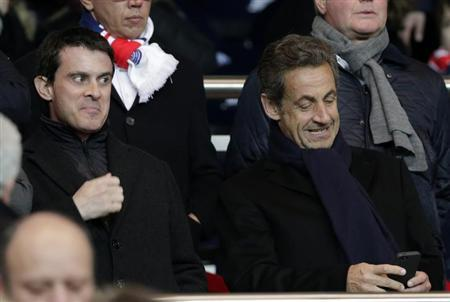 French Interior Minister Manuel Valls (L) and Former French President Nicolas Sarkozy (R) attend the French Ligue 1 soccer match between Paris Saint-Germain and Olympique Marseille at the Parc des Pri