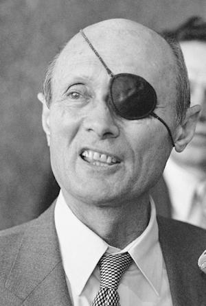 This Nov. 29, 1979 file photo, shows smiling former Israeli Foreign Minister Moshe Dayan during a brief press conference at O'Hare Airport in Chicago. Unidentified vandals desecrated the grave of former Israel Defense Minister Moshe Dayan overnight on Monday Oct. 15, 2012, at a cemetery in northern Israel. (AP Photo/Charles Knoblock, File)