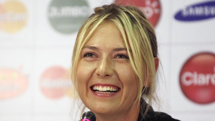Maria Sharapova of Russia smiles during a news conferences in Bogota