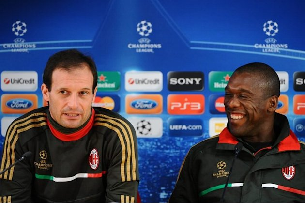 AC Milan's Massimiliano Allegri (left) and Clarence Seedorf speak on eve of match against Barcelona on November 22, 2011