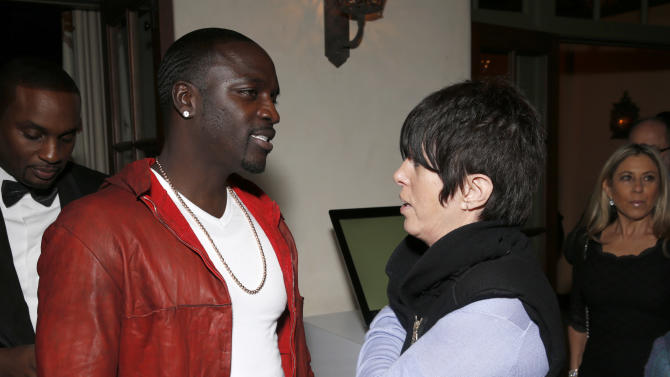 Akon and Diane Warren attend a Grammy Party hosted by Lucian Grainge on Sunday, Feb. 10, 2013 in Los Angeles. (Photo by Todd Williamson/Invision/AP)