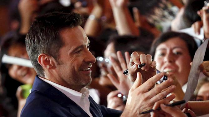 "Australian actor Hugh Jackman signs autographs for fans during the blue carpet premiere of ""Pan"" in Mexico City"