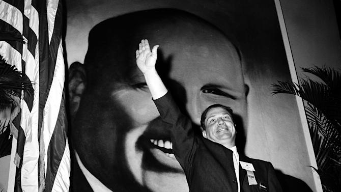 FILE - In this Sept. 30, 1957 file photo, Jimmy Hoffa, Teamsters vice president and leading candidate to succeed Dave Beck as the IBT's new president, waves to delegates at the opening of the Teamsters Union convention at Miami Beach, Fla. Hoffa's mysterious disappearance, assumed death and myriad searches for his body have been the stuff of urban legends for more than three decades and continue with the most recent report that the former Teamsters chief's remains are buried beneath a concrete slab in a barn in a field in suburban Detroit. (AP Photo/File)