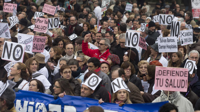 National health workers march during the first major demonstration of the year, in Madrid Monday Jan. 7, 2013. The demonstration was against government-imposed austerity measures and labor reforms in the public health care sector in Madrid. Main banners read 'Defend your health, Save banks and close hospitals, For the health.' (AP Photo/Paul White)