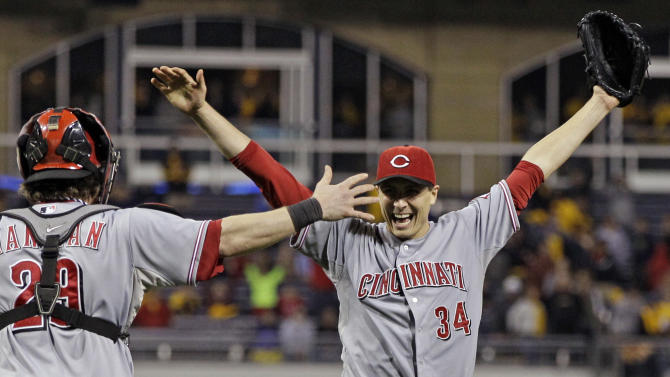 Cincinnati Reds starting pitcher Homer Bailey (34) celebrates with Cincinnati Reds catcher Ryan Hanigan (29) after getting the final out of a no-hitter in a baseball game against the Pittsburgh Pirates in Pittsburgh Friday, Sept. 28, 2012. The Reds won 1-0.  (AP Photo/Gene J. Puskar)