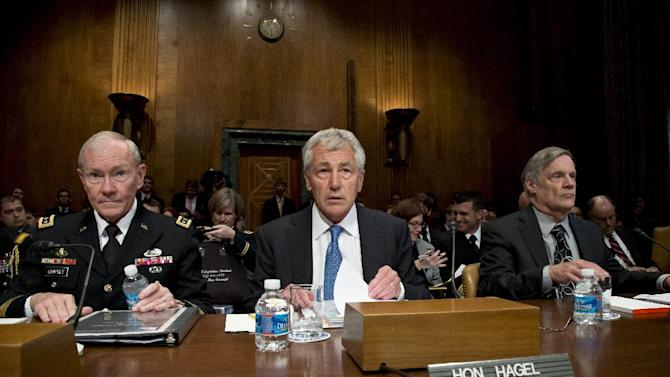 Defense Secretary Chuck Hagel, center, flanked by Joint Chiefs Chairman Gen. Martin Dempsey, left, and Pentagon Comptroller Robert Hale, prepares to testify on Capitol Hill in Washington, Wednesday, June 12, 2013, before Senate Budget Committee hearing on President Obama's fiscal 2014 budget requests for defense spending.  (AP Photo/J. Scott Applewhite)