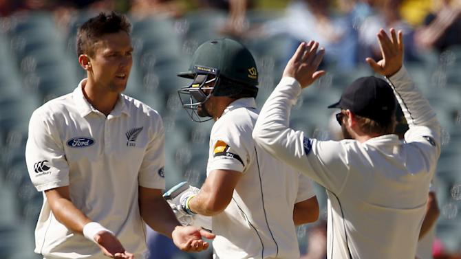 New Zealand's Trent Boult celebrates with team mates after dismissing Australia's Joe Burns LBW for 11 runs during the third day of the third cricket test match at the Adelaide Oval, in South Australia