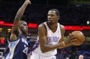 Thunder forward Durant is guarded by Grizzlies&#039; Pondexter in Game 5 of their NBA Western Conference semi-final playoffs in Oklahoma City