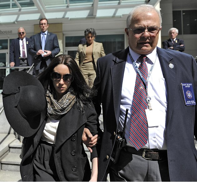 Casey Anthony leaves the federal courthouse in Tampa, with a U.S. Marshal after a bankruptcy hearing Monday, March 4, 2013.  Anthony, 26,  has not made any public appearances since she left jail after
