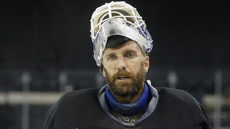 Rangers goalie Henrik Lundqvist leaves the ice after an optional practice ahead of Game 4 of the Stanley Cup final. The Kings have a 3-0 series lead over the Rangers. (AP)