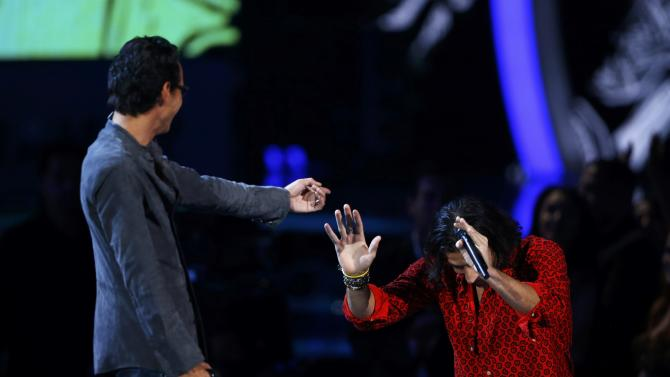 "Nasri from the band Magic! bows to Marc Anthony after perforning ""Cruel/Rude"" at the 15th Annual Latin Grammy Awards in Las Vegas"