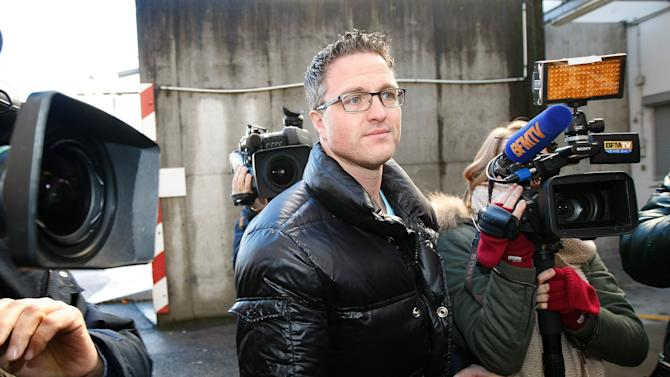 Michael Schumacher's brother Ralf arrives at Grenoble Hospital, French Alps, Sunday Jan. 5, 2014, where former seven-time Formula One champion Michael Schumacher is being treated after sustaining a head injury during a ski accident. Schumacher has been in a medically induced coma since Sunday, Dec. 29, 2013, when he struck his head on a rock while on a family vacation. (AP Photo/Claude Paris)