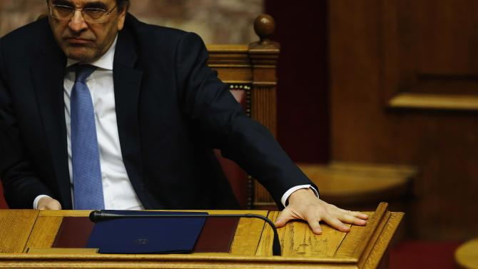 Greek Prime Minister Samaras reacts in parliament at the end of the last round of a presidential vote in Athens