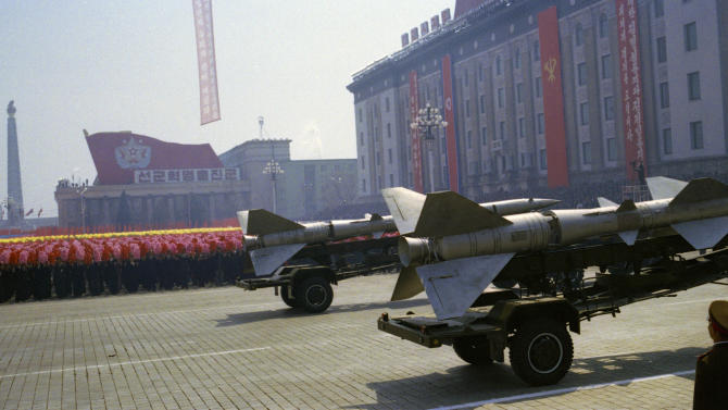 """FILE - In this April 15, 2012 file photo, North Korean rockets roll past flower waving civilians and a soldier standing at attention during a mass military parade in Pyongyang's Kim Il Sung Square to celebrate 100 years since the birth of the late North Korean founder Kim Il Sung. North Korea vowed Monday, Jan.14, 2013, to strengthen its defenses amid concerns the country may conduct a nuclear test as a follow-up to last month's long-range rocket launch. Citing U.S. hostility, Pyongyang's Foreign Ministry said in a memorandum that North Korea will """"continue to strengthen its deterrence against all forms of war.""""(AP Photo/David Guttenfelder, File)"""
