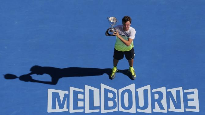 Safiullin of Russia poses with his trophy after defeating Hong of South Korea in their junior boys' singles final match at the Australian Open 2015 tennis tournament in Melbourne