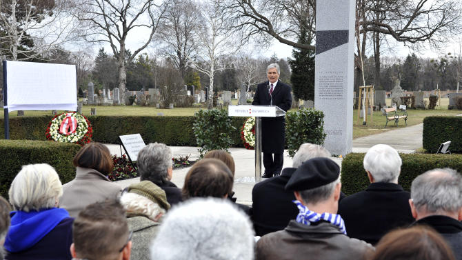 "Austrian Chancellor Werner Faymann delivers a speech during the unveiling of a plaque honoring the thousands of Austrians killed by the Nazis for opposing them, before and after the so-called ""Anschluss"" at the Central Cemetary in Vienna, Austria, Monday, March 11, 2013. Austria's chancellor has urged fellow Austrians to strive to prevent a return of the political climate that allowed Nazi atrocities, in comments marking Germany's annexation of Austria 75 years ago. (AP Photo/Hans Punz)"