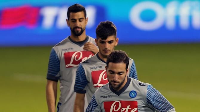 Napoli's Gonzalo Higuain and teammates take part in a training session in the Qatari capital Doha, on December 21, 2014, on the eve of their Italian Super Cup final match against Juventus