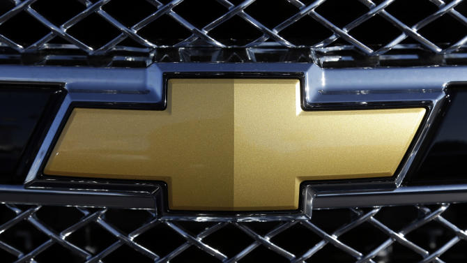 "In this Monday, Nov. 19, 2012, photo, the  Chevrolet logo is seen on the grill of a car at a dealership  in Clearwater, Fla. Chevrolet announced Tuesday, Jan 8, 2012 that it is dropping its ""Chevy Runs Deep"" slogan and replacing it with the new tagline ""Find New Roads,"" saying that it's better geared toward drivers outside the U.S. The General Motors Co. brand pointed to its significant overseas expansion over the past several years, noting that it now sells its vehicles in more than 140 markets around the world.  (AP Photo/Chris O'Meara)"