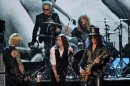 Guns N' Roses' Duff McKagan, left, Matt Sorum, top left, Steven Adler, top right, and Slash, right, perform with guest vocalist Myles Kennedy after induction onto the Rock and Roll Hall of Fame Sunday, April 15, 2012, in Cleveland. (AP Photo/Tony Dejak)