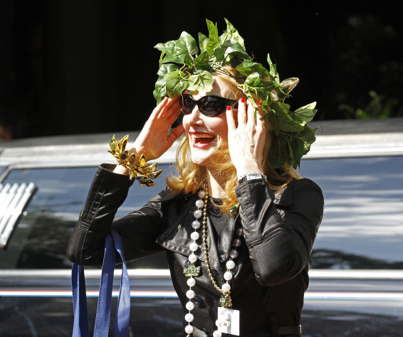 Actress Patricia Clarkson arrives at the Windsor Court Hotel in New Orleans, Wednesday, Feb. 15, 2012. Clarkson will preside over the all-women Mardi Gras Krewe of Muses parade. The parade will march through the streets of the city Thursday night. (AP Photo/Bill Haber)