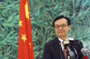Chinese Commerce Minister Gao attends a news conference in Beijing
