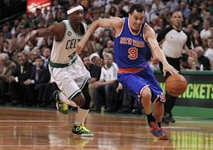 New York Knicks Pablo Prigioni of Argentina drives past Boston Celtics Jason Terry during the first half of Game 3 of their NBA Eastern Conference semifinal playoff basketball series in Boston