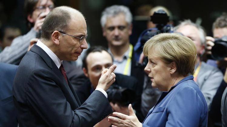 Italy's PM Letta talks to Germany's Chancellor Merkel during a EU leaders summit in Brussels