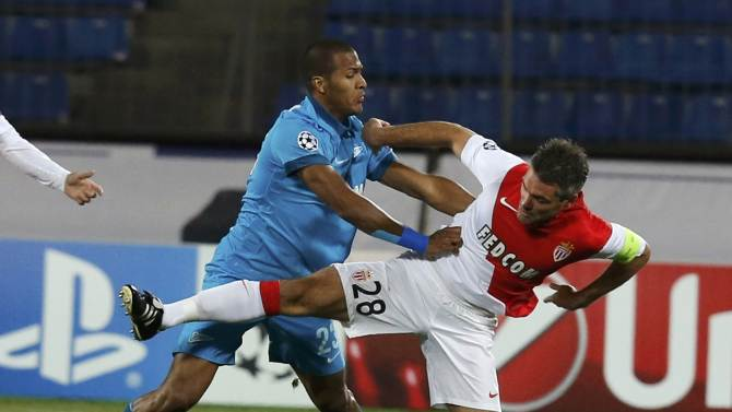 Zenit St. Petersburg's Jose Rondon fights for the ball with AS Monaco's Jeremy Toulalan during their Champions League soccer match at the Petrovsky stadium in St. Petersburg