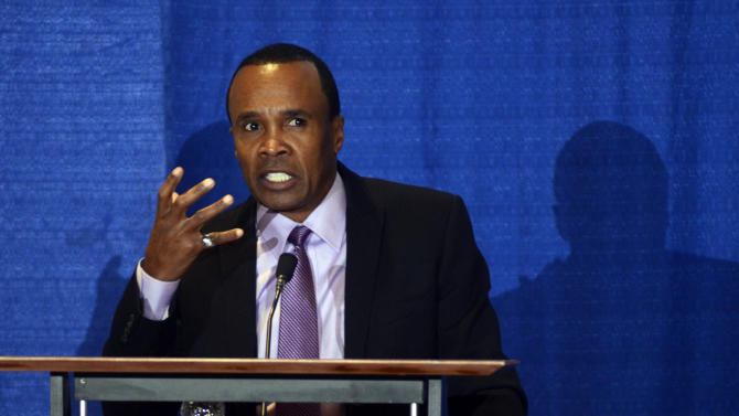 World title boxer Sugar Ray Leonard speaks regarding his personal experiences of abuse at the Child Sexual Abuse Conference in State College, Pa., Monday, Oct. 29, 2012. (AP Photo/Ralph Wilson)