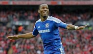 Chelsea and Ivory Coast idol Didier Drogba (pictured in May) on Wednesday sealed a two-and-a-half-year deal with Shanghai Shenhua, becoming the biggest recruit so far to China's ambitious Super League