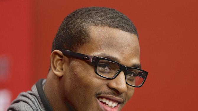 Nebraska running back Ameer Abdullah laughs at a news conference in Lincoln, Neb., Thursday, Jan. 16, 2014. Abdullah said he is returning to Nebraska instead of declaring for the NFL draft after his junior season
