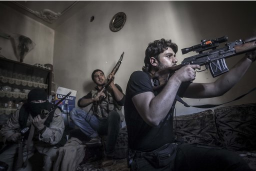 In this Monday, Oct. 29, 2012 photo, a rebel sniper aims at Syrian army positions in the Aleppo Jedida district, Syria. Syrian fighter jets pounded rebel areas across the country on Monday with scores of airstrikes that anti-regime activists called the most widespread bombing in a single day since Syria's troubles started 19 months ago.