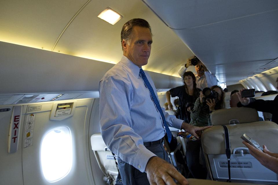 Republican presidential candidate, former Massachusetts Gov. Mitt Romney speaks with the press during a flight to Hyannis-Barnstable Municipal airport for fundraising events on Saturday, Aug. 18, 2012, in Hyannis, Mass.  (AP Photo/Evan Vucci)