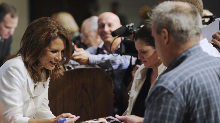 Republican presidential candidate, Rep. Michele Bachmann, R-Minn. signs autographs after addressing a National Press Club luncheon in Washington, Thursday, July 28, 2011. (AP Photo/Cliff Owen)