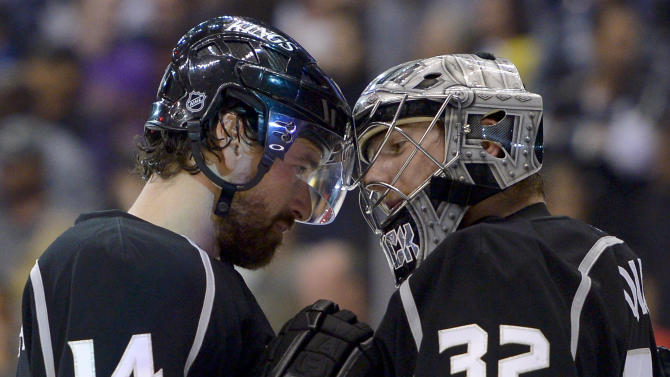 Los Angeles Kings right wing Justin Williams, left, greets goalie Jonathan Quick after their 2-1 win against the San Jose Sharks in Game 7 of the Western Conference semifinals in the NHL hockey Stanley Cup playoffs, Tuesday, May 28, 2013, in Los Angeles. (AP Photo/Mark J. Terrill)