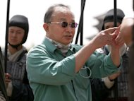 John Woo may have throat cancer