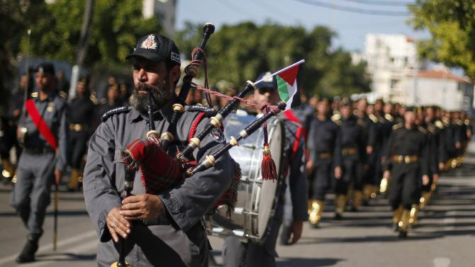 Members of Palestinian security forces loyal to Hamas take part in a parade in Gaza City