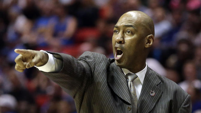 FILE - In this March 21, 2014 file photo, Tulsa head coach Danny Manning gestures as his team plays UCLA during the second half of a second-round game in the NCAA college basketball tournament in San Diego. A person familiar with the situation says Wake Forest has hired Manning as its next men's basketball coach. The person spoke to The Associated Press on Friday, April 4, 2014, on condition of anonymity because the school had not announced the hiring. (AP Photo/Lenny Ignelzi, File)