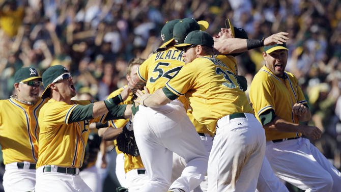 The Oakland Athletics celebrate their 12-5 win over the Texas Rangers in a baseball game, Wednesday, Oct. 3, 2012 in Oakland, Calif. The A's clinch the AL West title with the win. (AP Photo/Ben Margot)