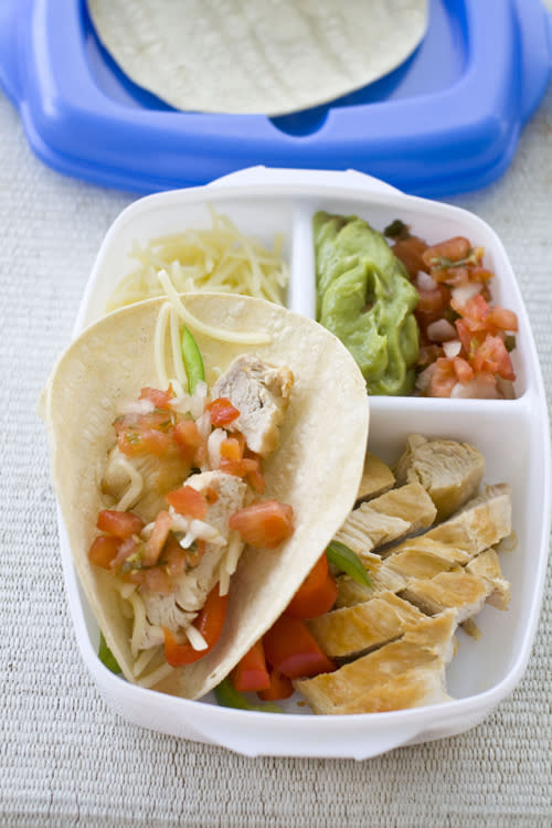 """FILE - This July 6, 2011 file photo shows ingredients for chicken fajitas in Concord, N.H. Today's lunch """"systems"""" are dominated by bento-style gear, which originated in Japan and involve multiple compartments and containers to hold a variety of foods. And that makes sense for modern kids, who are as likely to be toting sushi and DIY taco kits as they are the classic PB&J. (AP Photo/Matthew Mead, File)"""