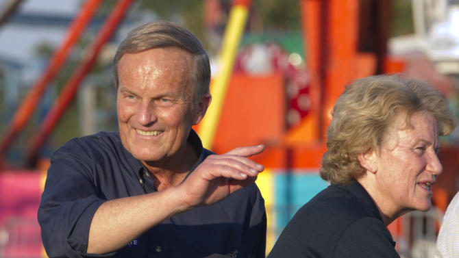 """Senate candidate Rep. Todd Akin, R-Mo., campaigns his wife Lulli, right, during the Northwest Missouri State Fair in Bethany, Mo., Thursday, Aug. 30, 2012. It was Akin's first public interaction with voters since his Aug. 19 comment in a TV interview that women's bodies have ways of averting pregnancy from what he called """"legitimate rape."""" The comment prompted widespread backlash, with some Republicans urging him to quit the race against Democratic Sen. Claire McCaskill. (AP Photo/Orlin Wagner)"""