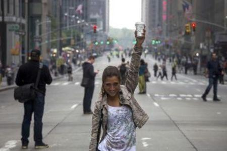 Silvia Paoletti of Tuscany, Italy, poses for a family member along 6th Avenue after it was closed to vehicle traffic ahead of the People's Climate March in Midtown, New York