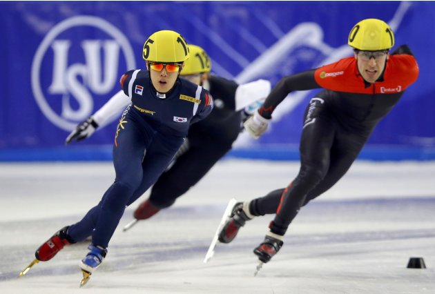 Sin of South Korea and Gilday of Canada compete during the men's 1500m heats at the ISU World Short Track Speed Skating Championships in Debrecen