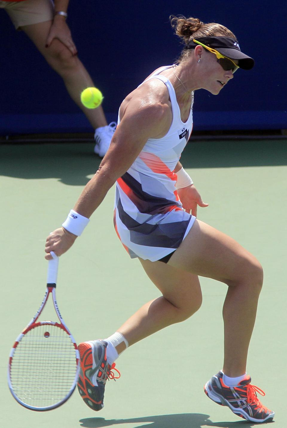 Samantha Stosur, from Australia, hits a backhand shot against Venus Williams during a quarterfinals match at the Western & Southern Open tennis tournament, Friday, Aug. 17, 2012, in Mason, Ohio. (AP Photo/Al Behrman)