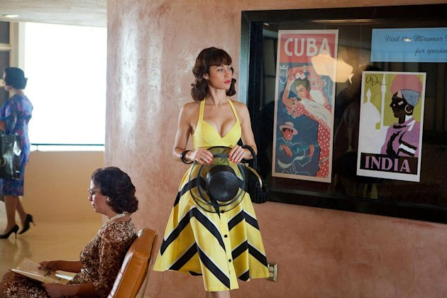 "Olga Kurylenko stars as Vera Evans in ""Magic City."""