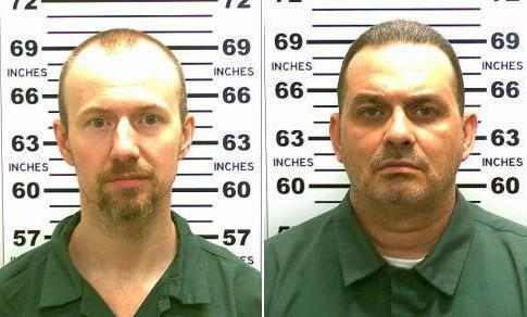 """FILE - At left, in a May 21, 2015, file photo released by the New York State Police is David Sweat. At right, in a May 20, 2015, file photo released by the New York State Police is Richard Matt. Joyce Mitchell, a prison worker who was """"in over her head"""" with the two inmates convicted of murder, tearfully pleaded guilty, Tuesday, July 28, 2015, to charges of aiding them by smuggling hacksaw blades and other tools to the pair, who broke out and spent three weeks on the run. (New York State Police via AP, File)"""