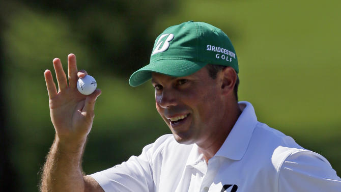 Matt Kuchar holds up his ball after a birdie putt on the seventh green during the third round of the Masters golf tournament Saturday, April 7, 2012, in Augusta, Ga. (AP Photo/David J. Phillip)