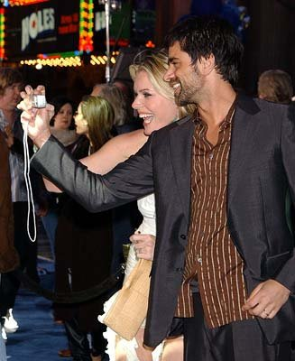 Premiere: Rebecca Romijn Stamos and John Stamos at the Hollywood premiere of 20th Century Fox's X2: X-Men United - 4/28/2003